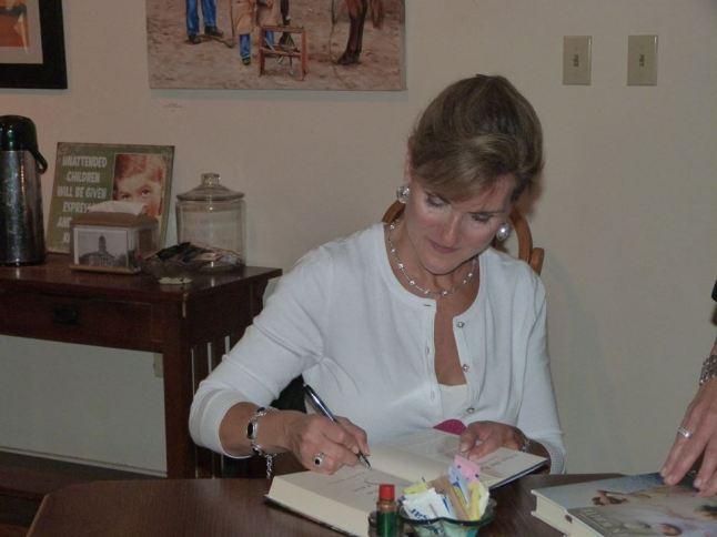 Karen signing a book