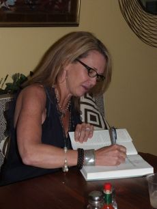 Patti Callahan Henry signng a book